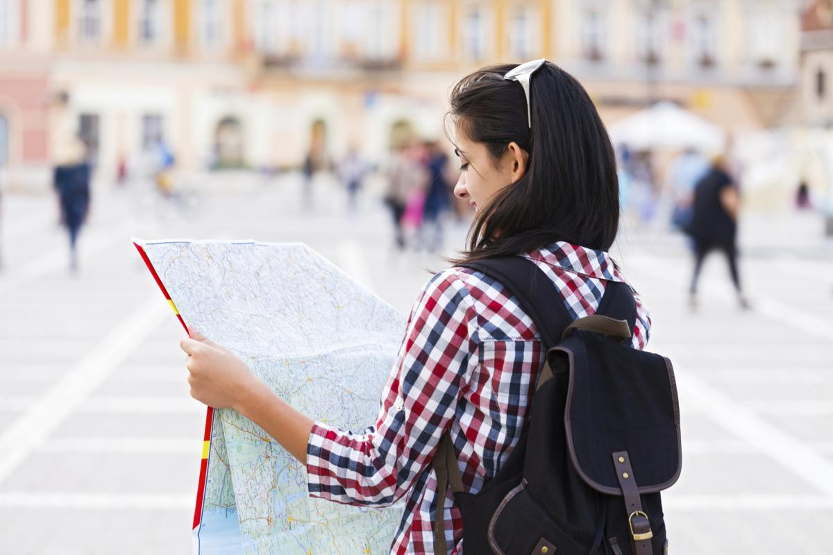 1200-477079655-girl-tourist-with-map