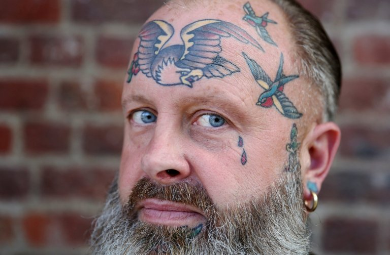 A tattoo enthusiast poses at the International London Tattoo Convention in London, Britain September 23, 2016. REUTERS/Neil Hall