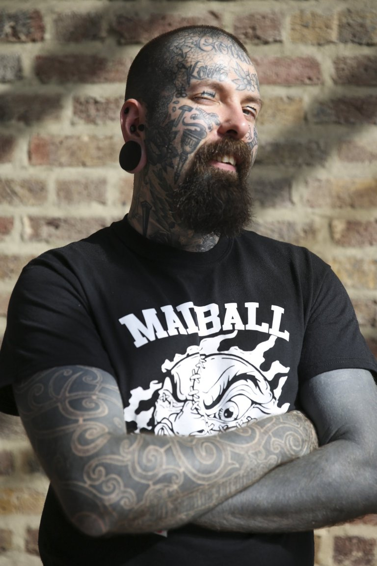 Tattoo enthusiast, Joni Makinen, at the London Tattoo convention in Shadwell, East London.  . 23 September 2016.