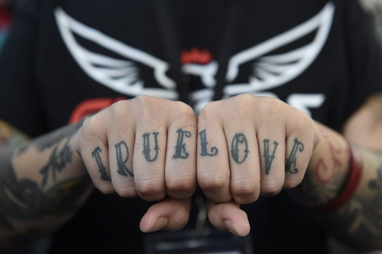 epa05553642 A tattoo enthusiast poses for photos at the London Tattoo Convention in London, Britain, 23 September 2016. The International London Tattoo Convention runs from 23 to 25 September brings together tattoo artists from the US, Australia, Canada, Japan and UK.  EPA/FACUNDO ARRIZABALAGA