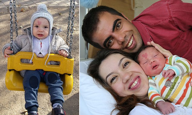PIC BY MURAT ENGIN / CATERS NEWS - (PICTURED:Adorable baby born with heartshaped birthmark) - Meet the special baby born with a heart shaped birthmark on his forehead. New parents Murat Engin, 30, and his wife Ceyda, 28, couldnt believe their eyes when their Baby Cinar was born with a red mark on his forehead. The tot was such a star in the delivery room that even the nurses took selfies with him. nar, 14 month old is the first in the family with the special love heart mark. And his besotted parents say he has lots of fans who want to stop and snap photos with this love child. SEE CATERS COPY